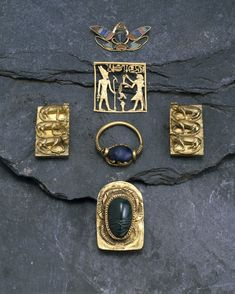 Gold finger-ring set with lapis lazuli scarab; name of Intef on base.       Lapis lazuli     gold -      17th Dynasty. Egypt,Thebes