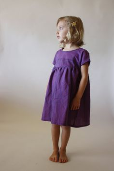 The Baja dress! Its a breeze to sew and includes sweet details like dolman-style capped sleeves, gathering at the bodice, a button back closure, Little Girl Outfits, Little Girl Fashion, Kids Fashion, Dress Anak, Girl Dress Patterns, Sewing Patterns For Kids, Couture Sewing, Play Dress, Girls Dresses