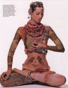 Have always loved this photo of Christy (yeah, we're on a first name basis) but feel more connected (such a yoga word) to it now. It's a cool representation of the highest of high fashion and a gorgeous yoga posture, appearing deep in the pose.