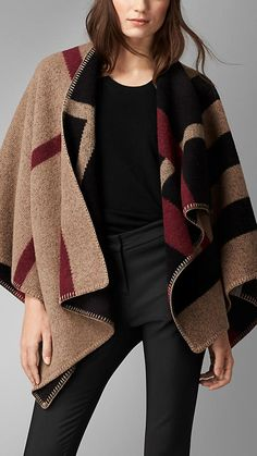 Burberry Check Wool and Cashmere Blanket Poncho - A reversible blanket poncho crafted in Scotland from wool and cashmere. Inspired by traditional equestrian blankets, the design is jacquard-woven with a check pattern. Discover the poncho collection at Burberry.com
