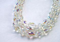 Aurora Borealis Glass Bead Necklace Three Strands via Etsy.
