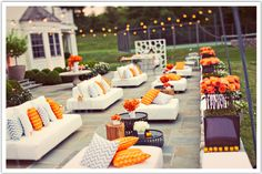 Custom orange chevron pillows for a fun lounge.  Design by Alchemy Fine Events
