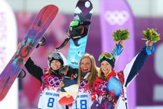 From left, silver medalist Enni Rukajarvi of Finland, Anderson, and bronze medalist Jenny Jones of Britain pose during the flower ceremony for the women\'s snowboard slopestyle.