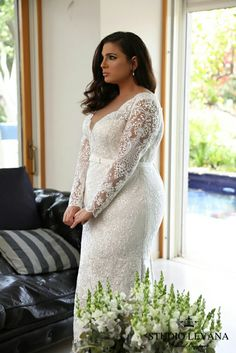 Unique fitted plus size wedding dress with sleeves