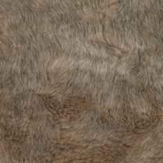 High-pile and light tan with black threads throughout, this faux fur is plush. Use it for trim on a jacket or coat (it would look especially lovely with gray) or make a muff. The choice is yours. If you'd really like to turn heads, this would make a fabulous vest.