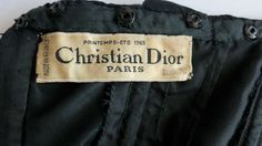 1965 CHRISTIAN DIOR Haute Couture Numbered black silk dress | From a collection of rare vintage evening dresses at http://www.1stdibs.com/fashion/clothing/evening-dresses/
