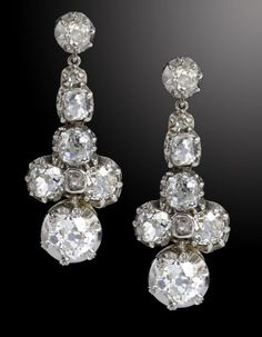 A PAIR OF DIAMOND EARRINGS of seven cushion shaped old cut diamonds, in white gold, fully articulated, 34mm, 6.4g, case signed for W S Fry, Nottingham  Sold @ Mellors & Kirk