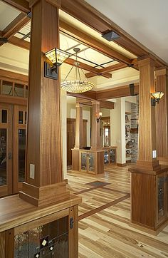 This Colorado Springs custom home entry way in craftsman decor was custom crafted by Brian Hubel. Its one of those like but don't like regarding all that wood House Styles, Bungalow Style, Craftsman Decor, Craftsman Trim, Inlay Flooring, New Homes, Craftsman House, House, Arts And Crafts Interiors