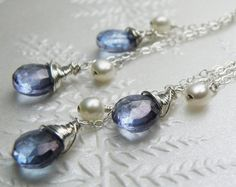 Beautiful blue quartz earrings are a statement pair at 2.5 inches long. Blue quartz and freshwater pearls are wire wrapped and dangle on fine sterling