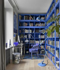 Actor and designer Andrey Rudensky chose a vibrant blue color scheme for the library of his Moscow apartment. The bookshelves are by Ikea and the floor lamp is by Jieldé.