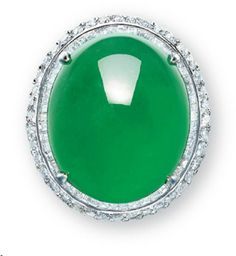 A JADEITE AND DIAMOND RING   Set with a thick high-domed oval jadeite cabochon of rich emerald green colour and very good translucency, to the baguette and brilliant-cut diamond surround and diamond-set quarter-hoop, mounted in 18k white gold, cabochon approximately 20.4 x 17.1 x 8.8 mm, ring size 6¼. Price realized: 1,460,000 HKD (USD 188,967)