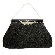 Vintage Black Caviar Beads evening  Bag  with silver and emerald Bird   From a collection of rare vintage evening bags and minaudières at https://www.1stdibs.com/fashion/handbags-purses-bags/evening-bags-minaudieres/