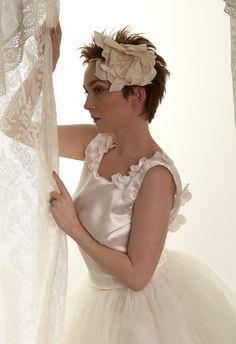 Large silk flower headband by  Rose Red Bridal Designs.so boho