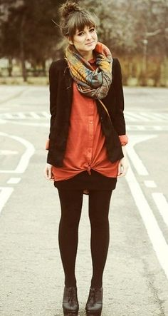 Large white or plaid blouse tied, with short black skirt,  black tights and short brown boots