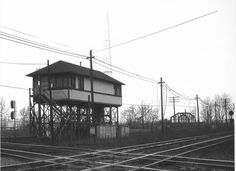 Olentangy Interlocking Tower located on the east side of the Olentangy River not far from Spruce St. Columbus, OH.  The camera is pointed southwest.  The NYC (Big Four) is crossing, first the PRR's Bradford line and after passing the tower, the C&O.