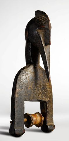 Africa | Heddle pulley from the Senufo people of the Ivory Coast | Wood.  ca. 1980s