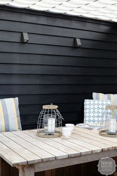 French affair: the home's weatherboards were stained with Porter's Paints Palm Beach Black. Outdoor Rooms, Outdoor Living, Weatherboard House, Gate House, Beach Cottage Decor, Beach Shack, French Cottage, House Extensions, Outdoor Wall Lighting