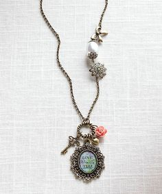 Look at this Goldtone 'Love Blooms Here' Pendant Necklace on #zulily today!
