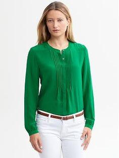 Style Note: You would look fabulous in this emerald green top. Try incorporating more items of this color into your wardrobe. This blouse is great for work or nice evening out. Pair with dark or light slacks or skirts and accessorize with simple jewelry and belt. (Silk pintuck blouse | Banana Republic)