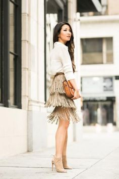 Want to work fringe at the office? Try a smart pencil skirt with swishy tiers paired with a silk blouse. #FallFashion #Fringe
