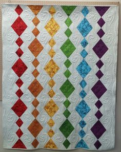 Dangling Diamonds quilt for Island Batiks. Quilted by Marlene Baerg Oddie at KISSed quilts. Bildergebnis für diamond in the rough quilt pattern Batik Quilts, Scrappy Quilts, Easy Quilts, Quilts For Kids, Jaybird Quilts, Charm Square Quilt, Charm Quilt, Bright Quilts, Colorful Quilts