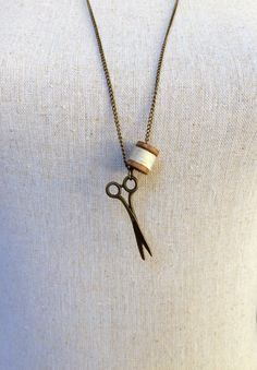 A personal favorite from my Etsy shop https://www.etsy.com/listing/222014593/white-scissors-and-thread-necklace