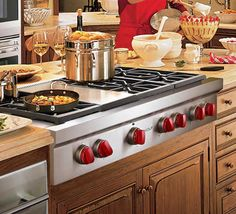 Wolf Gas Stove top with griddle!  Yes, please.  I know this isn't what you should look at, but I LOVE the red knobs!