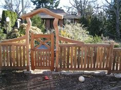 funky arbour from driftwood, and fencing made from hand split red cedar.