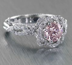 Flower-like Verragio engagement ring set with a pale pink sapphire (which we also carry!)