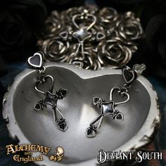 Last Chance! Alchemy Gothic E354 Amourankh Stud Earrings (pair)  A pair of delicate, pewter scrollwork ankh-heart earrings, with 6mm crystal/enamel details and suspended from black enamelled heart studs, with surgical steel posts and plastic scrolls.