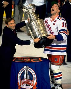 It's a wonderful pic. Captain Mark Messier accepting the Stanley Cup from the NHL commissioner, ending the 54-year championship drought for the New York Rangers. Pure joy. But I don't think I've ever seen a photograph of this moment in which Gary Bettman was so ... noticeable.