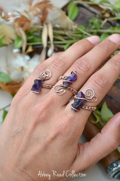 Adjustable Raw Amethyst Wire Wrapped Ring (1 Ring) This beautiful boho ring features a lovely piece of raw amethyst with a woven copper, adjustable ring band. Each ring and gemstone is unique, please check photos for the style ring (Labeled A, B or C) that corresponds with your