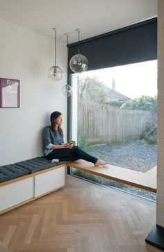 a built-in bench by the window, interior designer and avid furniture collector Kathryn Tyler's home in southwest England