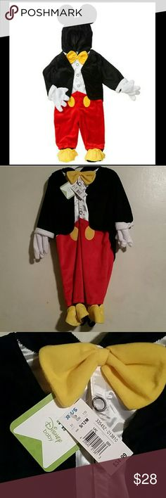 Mickey Mouse Costume Never been worn. Tags still on. My sons loves Mickey Mouse Clubhouse, and when we bought it it was way too big, then the following year it was too small.. Great condition. Needs a home! Costumes Halloween
