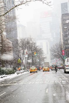 New York City snow falling, winter, yellow cabs. Why I would ever want to go to new York in the winter is beyond me, especially since I already think January in utah is bad, but I just have to go!