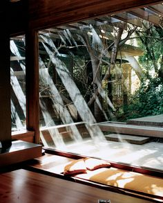 Wonderful light, created by wooden trellis beams extended out over the deck. More photos of great California-style architecture at the link