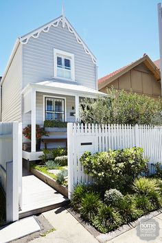 French affair: a white picket fence is the perfect match for this cute heritage cottage.
