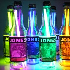 Empty bottles of Jones soda just add glow in the dark sticks. Cute centerpieces for summer party at night