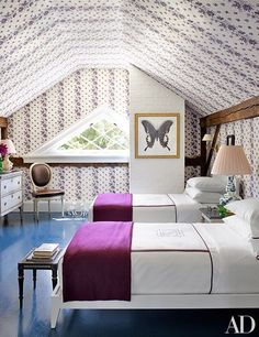 One of the spaces features Leontine Linens bedding and Alicia Adams Alpaca throws from Punch
