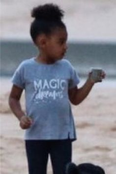 Blue Ivy Carter wearing Zara Magic Faded T-Shirt