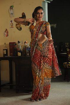 http://actresssareephotos.blogspot.in/2012/03/actress-andrea-jeremiah-hot-saree-navel.html