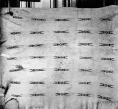 1900-1920 View of a painted buffalo hide created by Native Americans of the Piegan (Blackfoot) tribe, specimen no. IV-B, Museum fur Volkerkunde Berlin, Germany. It is stretched out and features rows of ornamental design.