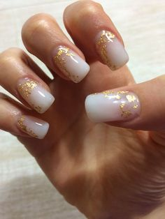Milky white gel nails with gold foil
