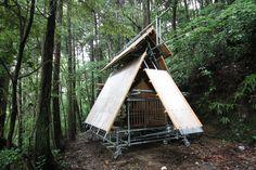 japanese architect kikuma watanabe creates a compact and wood-clad shinto shrine in a depopulated village in the mountainous region of kochi, japan.