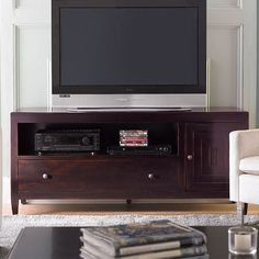 Crafted from Indonesian mahogany, this contemporary media console features a drawer under a matching compartment and a side cabinet.     ...