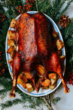 This Orange Five-Spice Roast Gooserecipe is an EPIC, classic Christmas dinner. We couldn't believe how flavorful the goose was and the potatoes cooked in the rendered goose fat are divine. Wild Game Recipes, Duck Recipes, Roast Goose Recipes, Carne, Wok Of Life, Comfort Food, Venison, Roasted Vegetables, Spices