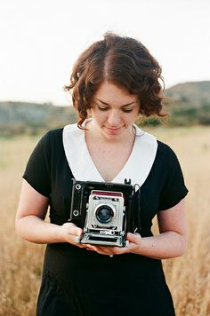 Pretty black and white dress and vintage camera