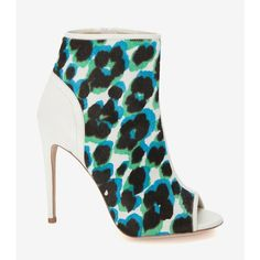 "An open toe bootie is certainly something to get wild over. 4 1/2"" heel. Zipper at side. Leather sole. In printed blue/green leopard spot haircalf and white le…"