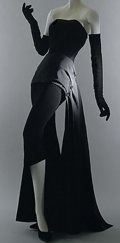 "Christian Dior, 1949.. In an odd way this reminds me of a version of a ""cat suit""."