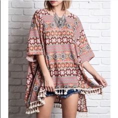The AMYLYNN print tassel tunic - TAUPE HP 8/7OK I'm a little bonkers for fun prints. Hope you share the same enthusiasm with patterns too. Fun tassel design, meant to be worn loose & boho chic style. This top really is a statement piece. ALSO AVAILABLE IN NAVY MIX. ‼️NO TRADE‼️ Tops Tunics
